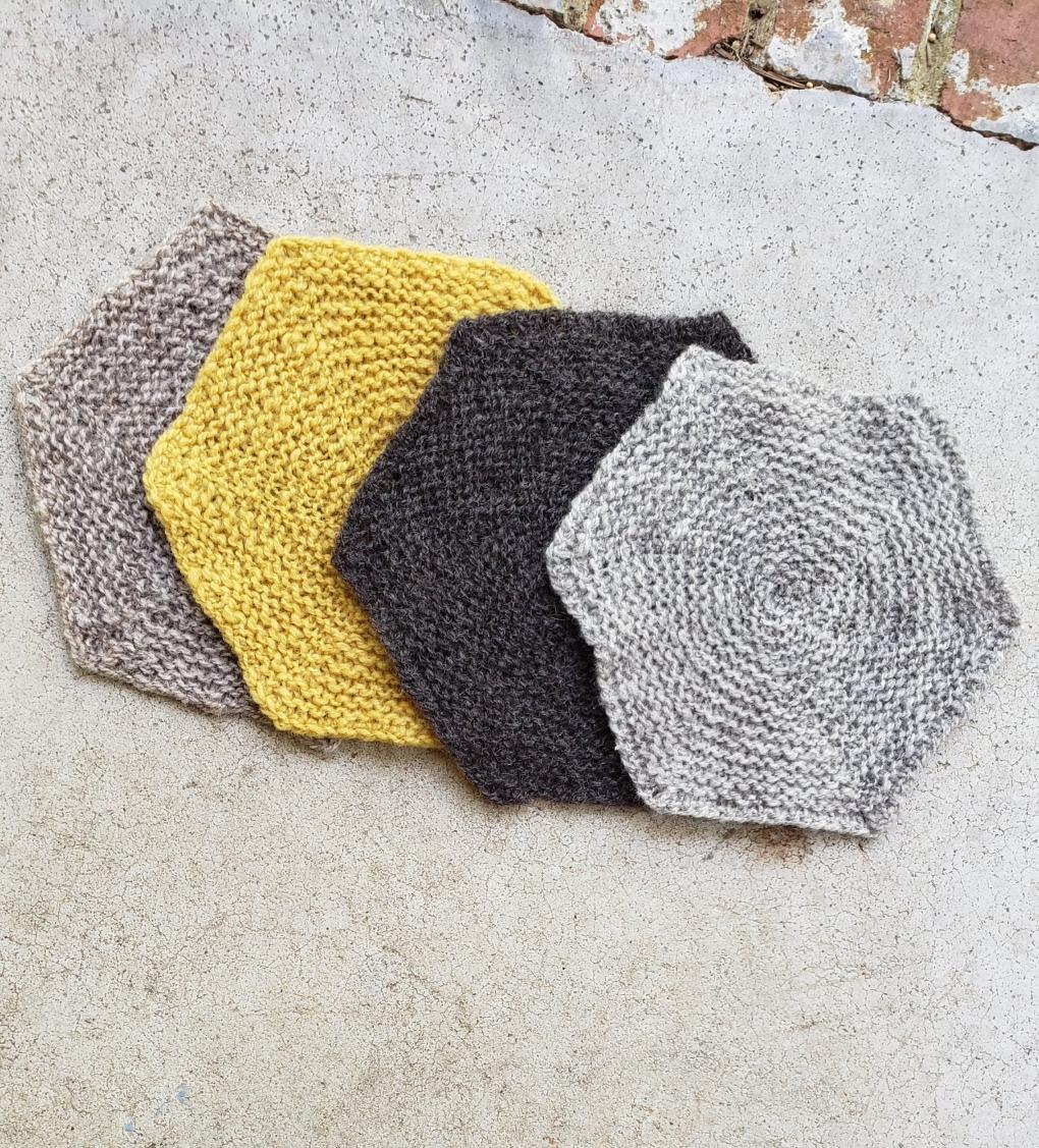 Four handknit hexagon blanket 'squares'
