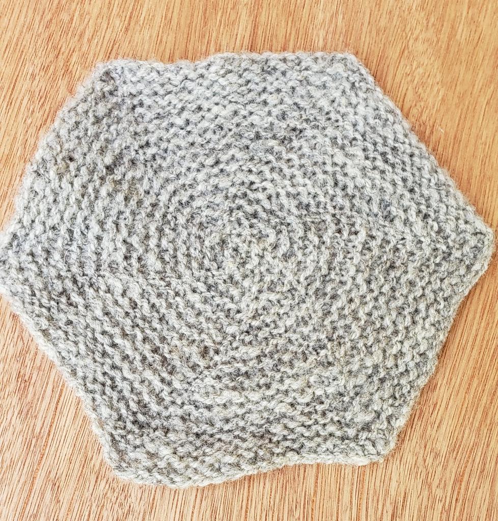A handknit hexagon blanket 'square' in Shetland wool