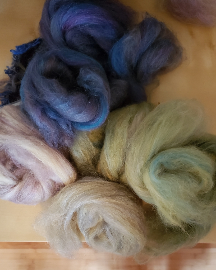 Nests of blended, dyed roving.