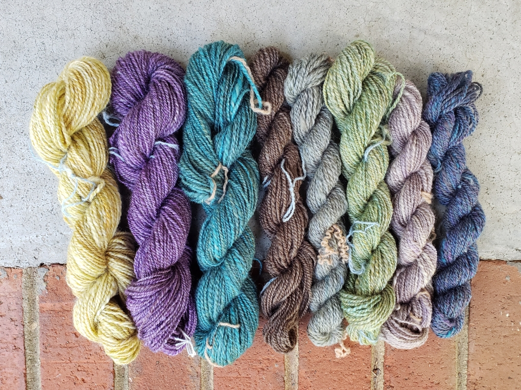 Eight skeins of solid-colored Polwarth/ silk yarn in various colors