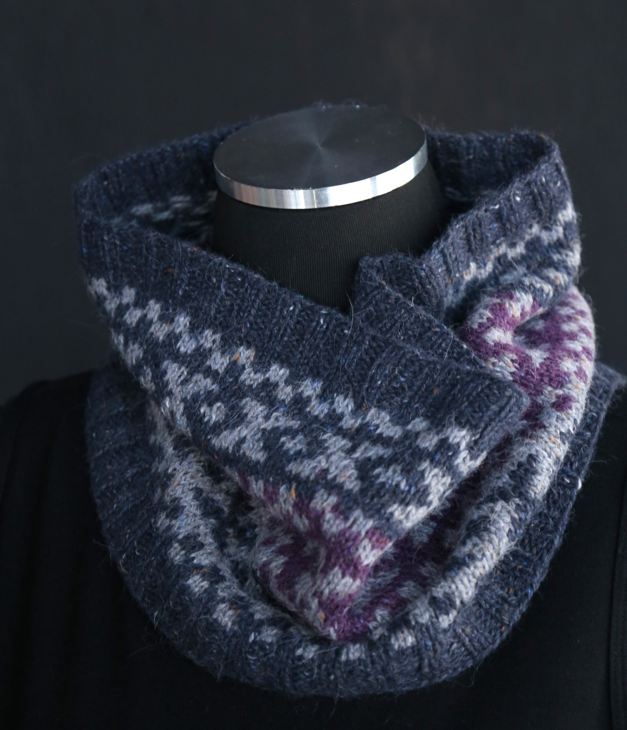 The S'mores Cowl, a handknit cowl featuring classic Fair Isle X's and O's